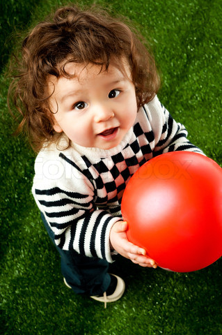 little kid with a red ball